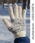 hand in glove covered with snow ... | Shutterstock . vector #1303120876
