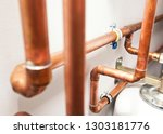 a lot of copper pipes in the...   Shutterstock . vector #1303181776