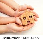 a little wooden house in women...   Shutterstock . vector #1303181779
