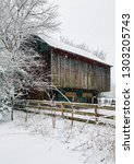 barn on a farm in the snow in... | Shutterstock . vector #1303205743