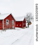 red barns on a farm in the snow ... | Shutterstock . vector #1303205893
