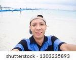 asian man happy enjoy selfie...   Shutterstock . vector #1303235893