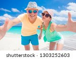 happy young couple having fun... | Shutterstock . vector #1303252603