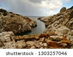natural harbor at the end of... | Shutterstock . vector #1303257046