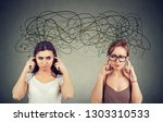 two angry displeased with each... | Shutterstock . vector #1303310533