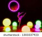 ballerina doll in neon lighting ... | Shutterstock . vector #1303337923