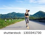 asian woman jogging on the road ... | Shutterstock . vector #1303341730