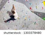 rock climber man hanging on a... | Shutterstock . vector #1303378480