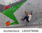 rock climber man hanging on a... | Shutterstock . vector #1303378486