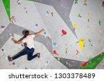 rock climber man hanging on a... | Shutterstock . vector #1303378489