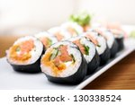 salmon and caviar rolls served... | Shutterstock . vector #130338524