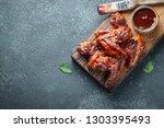 roasted chicken wings in... | Shutterstock . vector #1303395493