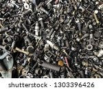Metal Junk nuts bolts sparkplugs dusty dirty old trash