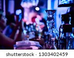 blurred barstand in night club... | Shutterstock . vector #1303402459