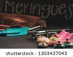 sweet meringues   meringue... | Shutterstock . vector #1303437043