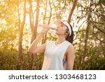asian women are jogging...   Shutterstock . vector #1303468123
