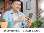 asian man online shopping with... | Shutterstock . vector #1303514293