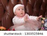 little girl five months in a... | Shutterstock . vector #1303525846