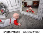 cute newborn baby in red with... | Shutterstock . vector #1303525900
