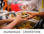 charity food for the poor... | Shutterstock . vector #1303537246