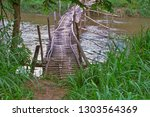 bamboo bridge river tropical... | Shutterstock . vector #1303564369