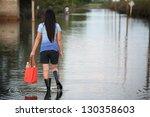 Girl Walking On Flooded Street...
