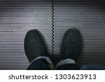 photo of feet standing on... | Shutterstock . vector #1303623913