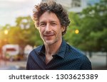 portrait of happy mature man... | Shutterstock . vector #1303625389
