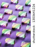 colorful marshmallow is laid... | Shutterstock . vector #1303641226