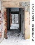 corridor of time. brick ruins... | Shutterstock . vector #1303641496
