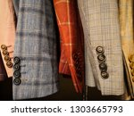 close up shot of some coats... | Shutterstock . vector #1303665793