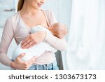 cropped shot of smiling young... | Shutterstock . vector #1303673173