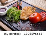 grilled duck meat served with... | Shutterstock . vector #1303696663