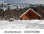 chalet covered with snow in the ...