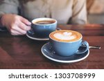 closeup image of a hand holding ...   Shutterstock . vector #1303708999