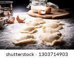 appetizing homemade dumplings. | Shutterstock . vector #1303714903