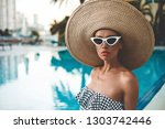 lifestyle portrait of beautiful ...   Shutterstock . vector #1303742446