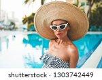 lifestyle portrait of beautiful ...   Shutterstock . vector #1303742449