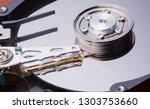 close up disassembled hard... | Shutterstock . vector #1303753660