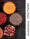 various superfoods in small... | Shutterstock . vector #1303756069