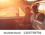 beautiful couple on road trip ... | Shutterstock . vector #1303758706