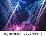 explosive and colorful holiday... | Shutterstock . vector #1303759546