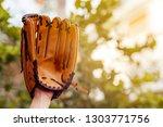 Hand holding baseball glove on...
