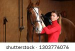 beautiful girl with her horse... | Shutterstock . vector #1303776076