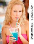 attractive blonde girl drinks... | Shutterstock . vector #130380224