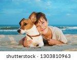 happy boy hugging his dog breed ...   Shutterstock . vector #1303810963