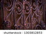 forged elements of the gate in... | Shutterstock . vector #1303812853