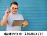 portrait of a confident mature... | Shutterstock . vector #1303816969