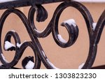 decoration of metal fence with... | Shutterstock . vector #1303823230