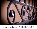 the forged elements decorating... | Shutterstock . vector #1303827523